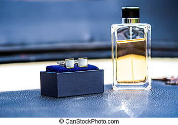 Stylish men's wedding accessories in a gift box , Cufflinks and perfume for groom.