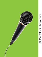 Stylish microphone on green background