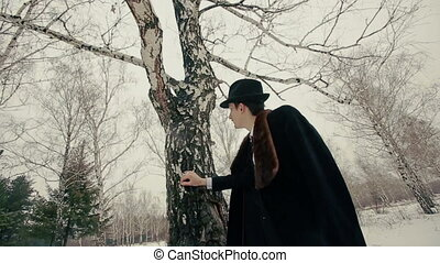 Stylish retro man looks at the Tree