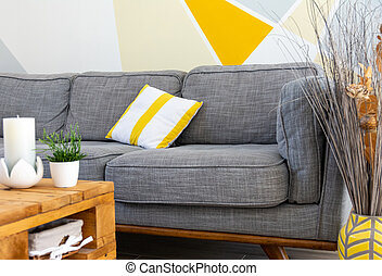 Stylish scandinavian style cozy living room interior with comfortable grey sofa