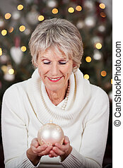 Stylish senior lady with a Christmas bauble