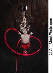 Stylish shisha from glass on a wooden background