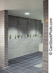 Row of showers in a stylish sports club bathroom