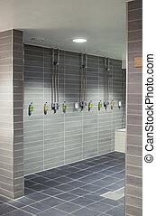 Row of showers in a stylish sports club bathroom