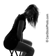 stylish silhouette of caucasian woman posing