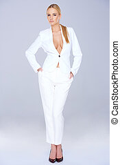 Stylish slender woman in a white slack suit