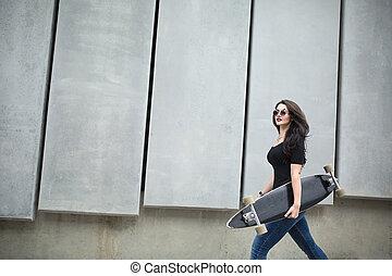 Stylish teenager girl with a longboard - Stylish teenager...