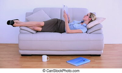 Stylish tired businesswoman falling asleep on couch in...