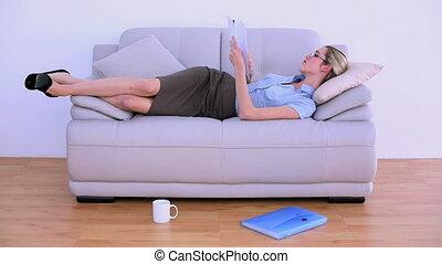 Stylish tired businesswoman falling asleep