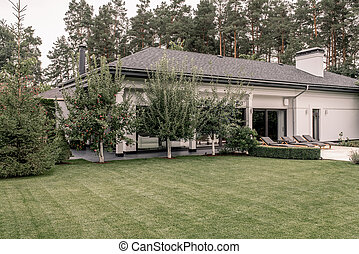 Stylish villa with column and large lawn