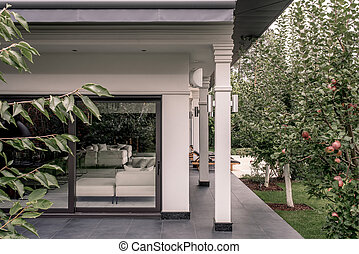 Stylish villa with columns and fruit trees