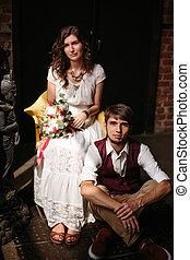 Stylish wedding couple in loft interior