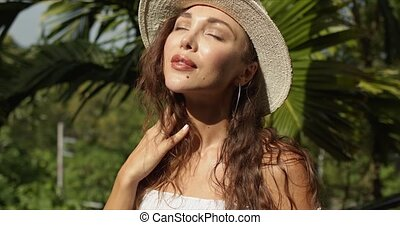 Stylish woman adjusting summer hat - Attractive female ...