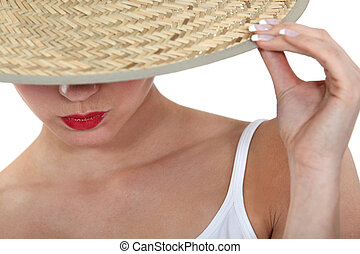 Stylish woman in a straw hat