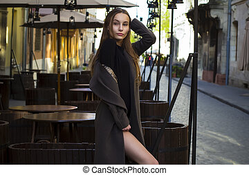 Stylish woman in coat at the street