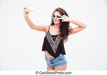 Stylish woman making selfie photo