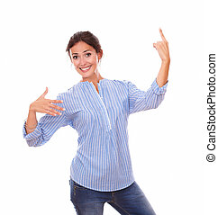 Stylish woman pointing up while standing