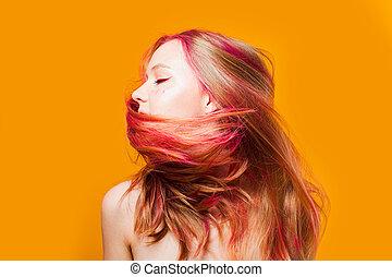 Stylish woman shaking head on yellow background