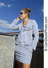 stylish woman speaks by mobile phone
