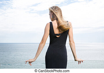 Stylish woman standing in fashion dress
