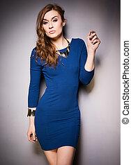 stylish woman wearing blue dress