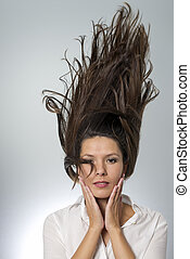 stylish woman with flying hair