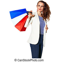stylish woman with shopping bags on white looking at copy space