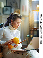 stylish woman with yarn learn how to knit