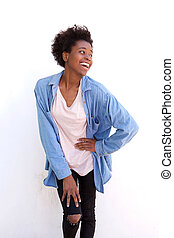 Stylish young african american woman standing against white background