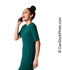 Stylish young african woman talking on her cellphone
