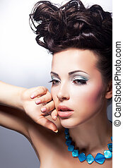 Stylish young beauty looking. Glamor and luxury