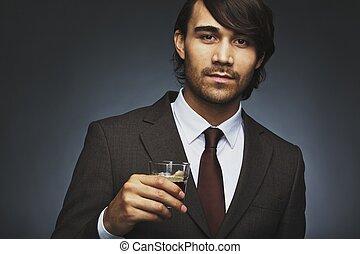 Stylish young businessman drinking coffee