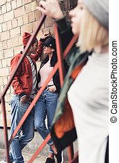 stylish young man flirting with woman