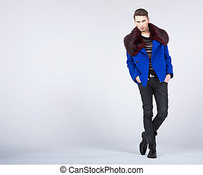 Stylish young man in fashion pose