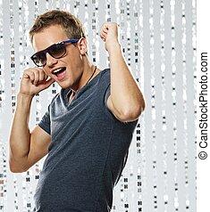 Stylish young man in the nightclub