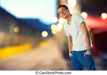 Stylish young man over blurred background