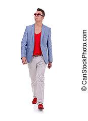 Stylish young man walking