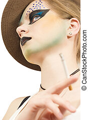 Stylish young model with a bright make-up
