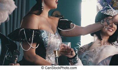 Stylish young people in tuxedo and luxury dress having fun...