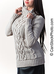 Stylish young woman in a knitted sweater