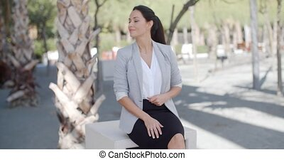 Stylish young woman in an urban park