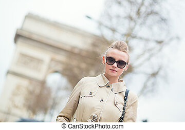 Stylish young woman in Paris
