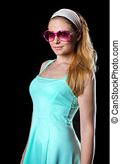 Stylish young woman in summer dress
