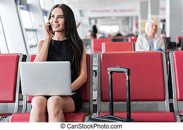 Stylish young woman is having important conversation