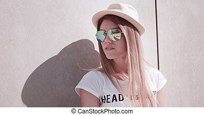 Stylish Young Woman Leaning Against the Wall