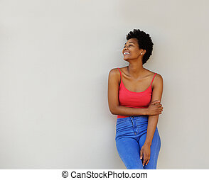 Stylish young woman looking away at copy space