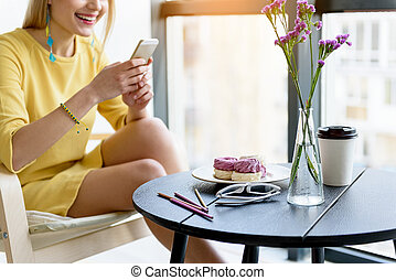 Stylish young woman making picture of food