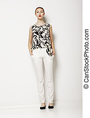 Stylish Young Woman Mod in Light Clothes over White Background. Fashion Style