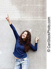 Stylish young woman pointing at copy space