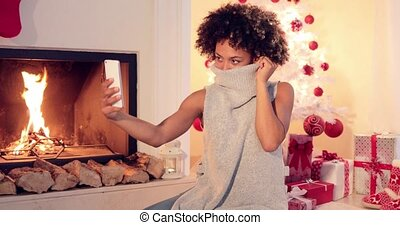 Stylish young woman taking a Christmas selfie